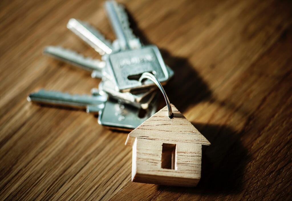 chaveiro em formato de casa, representando o fundo imobiliário.